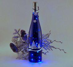 bottle light, Christmas trees, blue and white, blue lights wine+bottle+tree Wine Bottle Trees, Wine Bottle Glasses, Wine Bottle Corks, Diy Bottle, Wine Bottle Crafts, Blue Bottle, Recycled Wine Bottles, Painted Wine Bottles, Lighted Wine Bottles