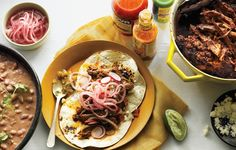 Chile-Braised Pork Shoulder Tacos - Bon Appétit Made these tonight with jicama slaw and home made pickled radishes.