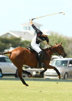 Audi's 10-goaler Gonzalito Pieres in perfect form hitting the ball downfield to teammate and younger brother Nico Pieres. Photo credit Alex Pacheco. http://phelpsmediagroup.com/viewarticle.php?id=7567