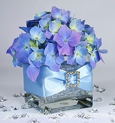 Purple hydrangea centerpiece with ribbbon and rhinestone buckle accent. #wedding #centerpiece #reception