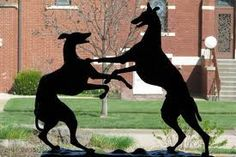 Bronze Greyhounds Playing by Anna Vaughn Hyatt Huntington (1876 - 1973)