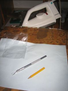 Make your own freezer paper for stencil: Black grocery bag or any plastic bag + Plain paper. Print - Fuse plastic to the back - Cut - Iron to fabric - Paint - Peel