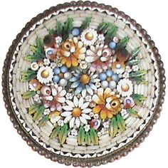 Offered for sale is this delightful antique Victorian silver micro mosaic brooch, possibly from Italy. It is marked on the back 800, slightly below