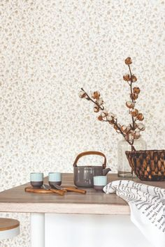 A gentle floral wallpaper design showing delicate, metallic gold flower heads