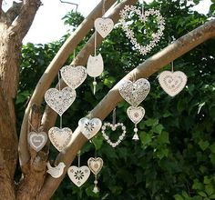 mixed in with the fabric streamers and round knit holders with lace - beautiful backdrop for ceremony - Idea for quillers: How about filling in these hearts with quilled shapes, such as snowflakes require!!