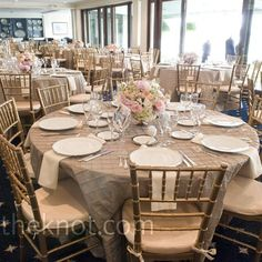 simple reception decor with taupe pintuck linens, ivory napkins and gold chiavari chairs.
