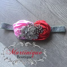 A personal favorite from my Etsy shop https://www.etsy.com/listing/586081491/red-and-light-pink-satin-puff-flowers