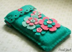I love my new iPhone cover. I made this from wool felt and it is so soft and pretty. I cut rectangles of felt x 8 cm (which were the measurements of the Mollie Makes cover gift template from. Felt Crafts Diy, Handmade Crafts, Fabric Crafts, Sewing Crafts, Felt Phone Cases, Felt Case, Pochette Portable, Felt Bookmark, Felt Hair Clips