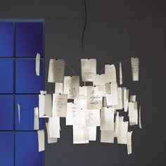 note card chandelier: make a chicken wire basket and thread heavy wire through it, with clips attached to the ends.
