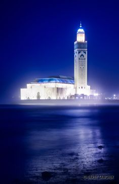 The Hassan II Mosque glows through the mists in the evening in Casablanca, Morocco