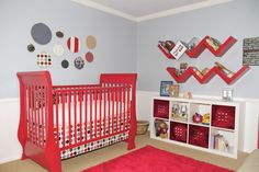 bright red nursery with alphabet wall