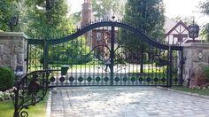 Decorative automated wrought iron entrance gate