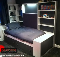 Custom made single bed with underbed storage and shelving. Designed for limited space in boys bedroom. Finished to customer requirements in stylish white and grey to match room scheme. Modern and simple design ideal for teenage style. Integrated lighting. http://www.spaceworksjoinery.co.uk/