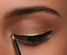 This subtle black-and-gold liner combo will look great with any party outfit.