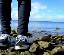 Inspiring picture boy, foot, sea, stones, water. Resolution: 500x333 px. Find the picture to your taste!