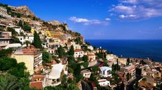 Terraced houses overlooking Italian coast. - an article giving you the must sees in Italy.