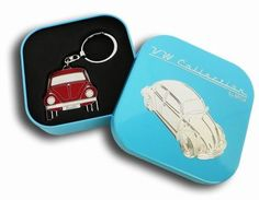 Key Rings with the design of the VW Beetle front, 4 different colors. Includes a individual tin gift box for each key ring. Material: chrome-plated metal with soft enamel finish. Size: cm Officially Licensed by Volkswagen Volkswagen, Red Beetle, Vw Super Beetle, Tin Gifts, Vw Beetles, Chrome Plating, Key Rings, Different Colors, Vw Bugs
