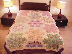 """Special Grandmother's Flower Garden variation, ebay seller: evintage; 92"""" x 67""""; all feed sacks, hand stitched, thin cotton batting, hand quilted,"""