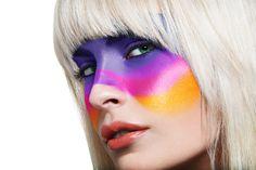 purple, pink and orange face paint makeup art.