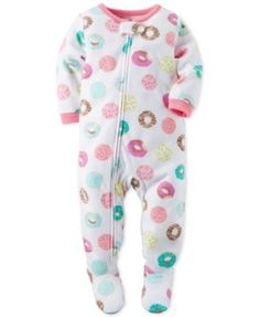 Bedtime is a whole lot sweeter with these fabulous donut-print footed pajamas-featuring an ankle-to-chin zipper for easy changes-from Carter's.   Polyester   Machine washable   Imported   Solid ribbed