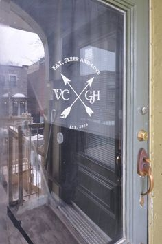 Window graphic on door, sign uses adhesive backing for glass surfaces. Apartment Therapy