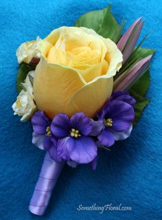 My groom boutonniere, containing a yellow Ecuadorian rose, small yellow spray rosebuds, a mauve lisianthus bud, and lavender violets. Only the ribbon will be a brown color!