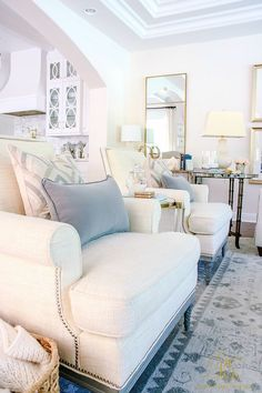 Those pillows! White chairs in a neutral living room. Transitional Family Room Reveal - Randi Garrett Design
