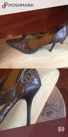 Cream and brown Faux snakeskin heels These are faux snake skin. Fun and sexy with any outfit. Wear on the inside of show reflected in the price Shoes Heels