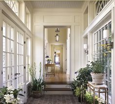 Love this back entranceway - herringbone brick floor, french doors, and palladian windows.