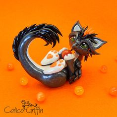 Tori - gunmetal griffin - clay sculpture - Premo Sculpey polymer figurine sculpture dragon gryphon graphite gray black silver orange orb