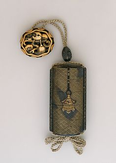 Inro, Ojime, Netsuke, 17th century  Costume/clothing accessory/waistwear, Four-case inro with gold lantern, gong in gold takamakie of gold and black togidashi lacquer; ivory ryusa manju with Buddhist emblems