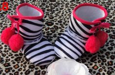 Zebra Pom Pom Boots! Check out this new boutique!!!  Its just starting but a lot of cute stuff!! :)
