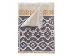 The Gilao Beach Towel is right on-trend this season, and guaranteed to make a style statement at the beach or spa. Displaying an Ikat-inspired, geometric motif on the front with a four-centimetre eyelet fringe on either end, this beach towel combines superior weaving craftsmanship with a modern take on tribal pattern. Using an intricate jacquard weave, the Gilao features shallow terry weave on the reverse, and a smooth finish on the front, ensuring the pattern looks its best. Thanks to this…