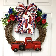 Red Truck Patriotic Wreath, Red Truck Decor, Patriotic Grapevine Wreath with Red Truck by WreathDecorbySusan on Etsy Fourth Of July Decor, 4th Of July Decorations, 4th Of July Wreath, July 4th, Patriotic Wreath, Patriotic Crafts, Red Truck Decor, White And Blue Flowers, Felt Christmas Decorations