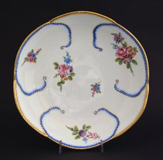 An 18th Century Sevres Porcelain Feuilles de Choux Saucer Shaped Dish. The Cabbage-Leaf Form Soft-Paste Porcelain Dish is Decorated with Scattered Bouquets of Garden Flowers. The Base Marked with an Interlaced LL for the Sevres Factory, a Date Letter Code `K` for 1763 and a Painters Mark.