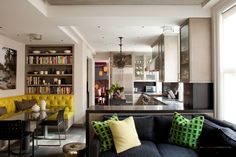 Black Sofa Color And Yellow Color In Kitchen Plus Bookcase Ideas On Kitchen Wall With L Shaped Kitchen Islands.jpg Awesome Kitchen Interior with Sofa as the New Line of Kitchen Design Kitchen