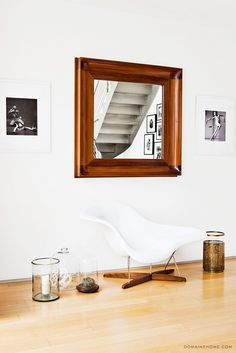 My living room. I love this mirror and got it from the designer Ernie del la Torre. It's based on a mirror in the Ralph Lauren mansion (Ernie used to work for Ralph Lauren). I LOVE the Eames chair and think it is one of the most gorgeous designs of all time.