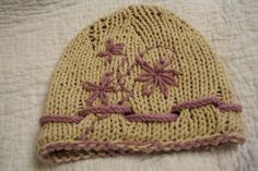 http://www.ravelry.com/patterns/library/lilys-hat-3