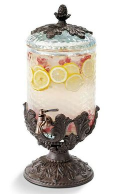 This Baroque beverage dispenser brings a timeless European flair to your table.