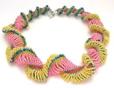 Pink and Yellow Double Dutch Spiral This necklace is a happy statement piece. It is feminine and flirty and a true one-of-a-kind. It is the
