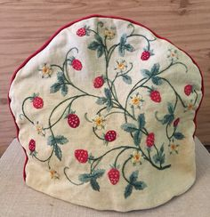 A personal favorite from my Etsy shop https://www.etsy.com/listing/263702001/tea-cozy-hand-embroidered-vintage-linens