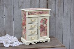 Hand painted and decoupaged vintage jewelry box. Wood, painted a soft cottage white and lightly distressed with decoupage made to look like weathered aqua wood with roses and finished with a protectiv