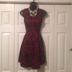 Red & Black A-Line Skirt Dress in Juniors NWOT never worn before without lining. Made of 54% Polyester, 30% Cotton and 16% Cotton. HeartSoul Dresses Midi