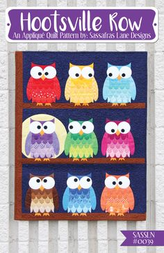 "This fun owl quilt would liven up any wall! Grab your scrap bin and get appliquéing! Move the eyes around to create a fun Brady Bunch family style of owls! Hootsville Row finishes 27"" x 36""."