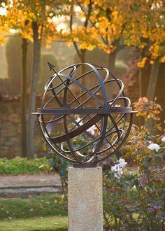 Bronze armillary sundial in the autumn