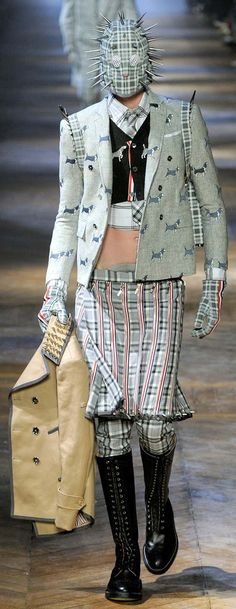 outrageous outfit seen on the runway similar to how Petrutchio showed up at his wedding in mangled, mix-matched clothing.