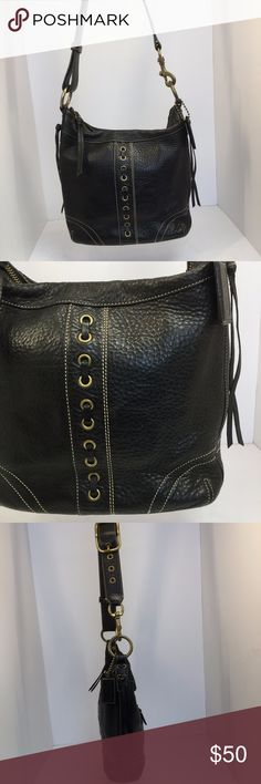 "Coach Soho Stitch Black Leather Shoulderbag Purse Coach Soho stitch leather shoulder bag with large brass hardware. Pebbled leather with distressed look. Adjustable strap with large buckle. Leather laced stitched front. Tassels on sides. Keychain. 1 outside zipper pocket on back. Main pocket zips closed. 1 inside zipper pocket. 2 inside open side pockets. Ring inside to clip keys.  Serial #: f06s-10399  Height: 10.5""  Length: 11""  Depth: 3""  Color: Black  Material: Leather  Condition…"