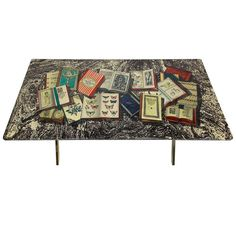 Piero Fornasetti Libri Coffee Table | From a unique collection of antique and modern coffee and cocktail tables at http://www.1stdibs.com/furniture/tables/coffee-tables-cocktail-tables/