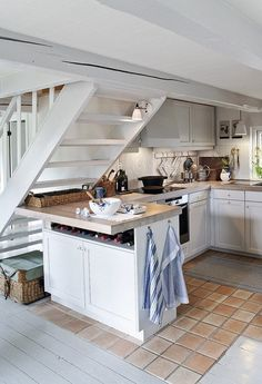 cozy and well-organized kitchen (via one kind design) - my ideal home...