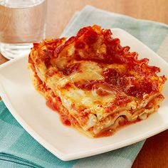 This tasty recipe for #SlowCooker Lasagna doesn't even require you to boil noodles! Easiest. Lasagna. Ever.